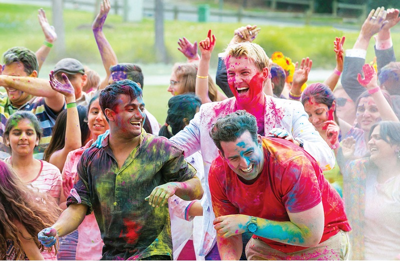 A scene from the film UnIndian that shows Lee playing Holi
